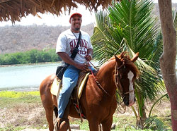 Byron riding horseback on vacation